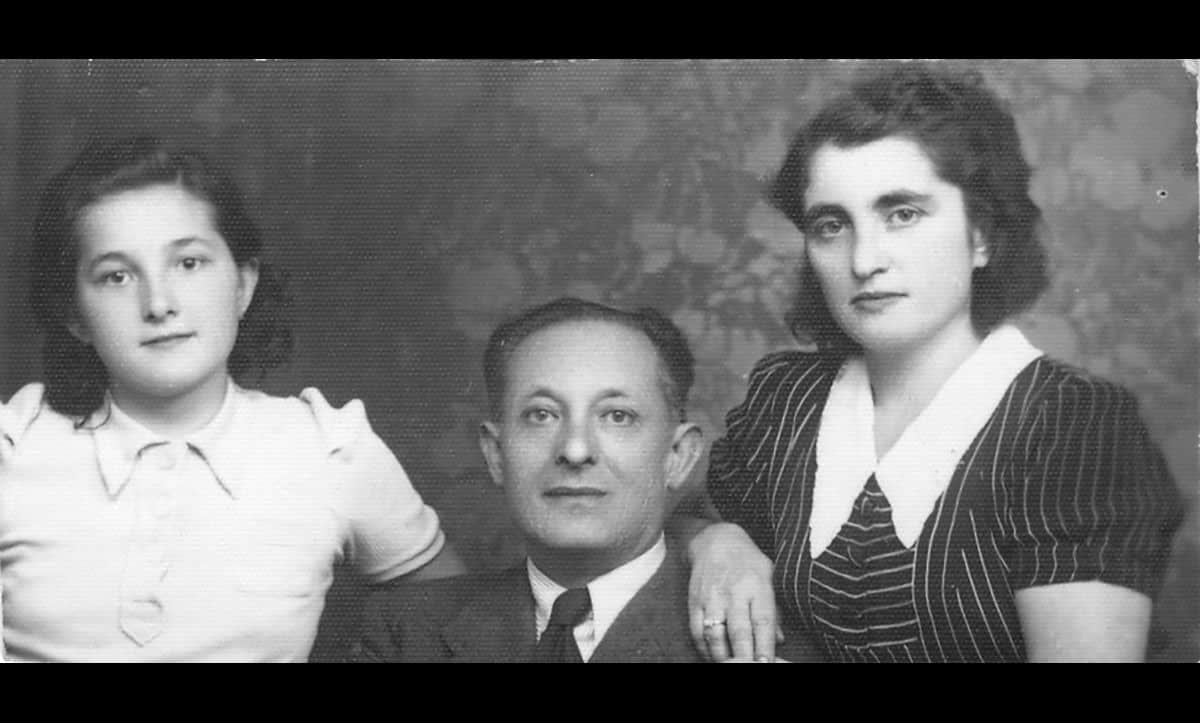 [From left to right] Sonja, Adolf and Lotte Jaslowitz, a Jewish family from Czernowitz, a city in north Romania. On 4 June 1942, having survived the first Einsatzgruppen sweep through the city, the family were deported to Ladijin Concentration Camp. Throughout the next three years, the family endured horrific and unsanitary conditions in several ghettos and camps. Only Lotte survived the war.