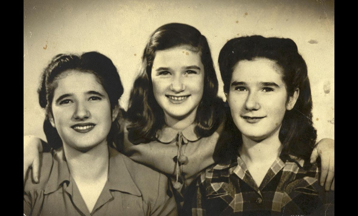 Following their mother's death, the three Wiener girls – Ruth, Eva and Mirjam – continued their journey alone. They were reunited with their father – whom they had not seen for almost six years - in New York in February 1945. This photograph was taken a year after their liberation in 1946.