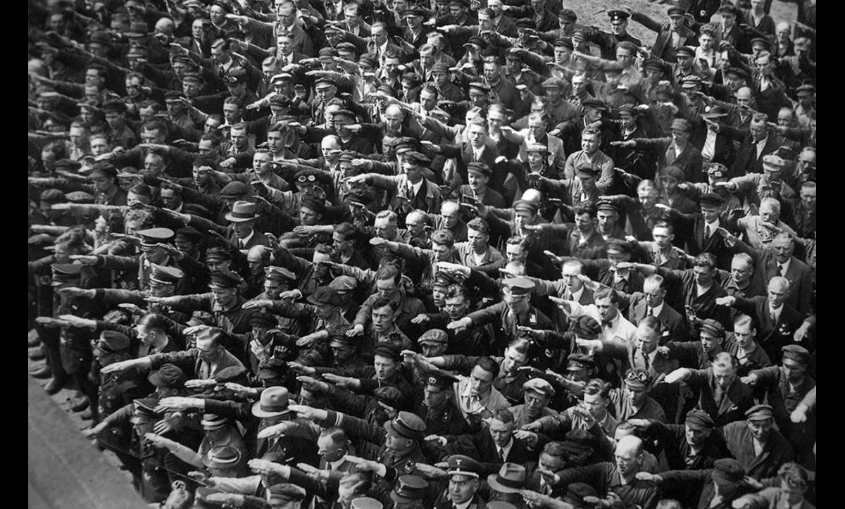 This photograph shows the launch of a new German navy vessel at the Blohm and Voss shipyard in Hamburg in 1936. In the top right-hand corner of the photograph, one man, believed to be August Landmesser, is not giving the Nazi salute like the rest of his colleagues. Landmesser was opposed to the Nazis and their racial worldview. His partner, Irma Eckler, was Jewish. Landmesser was later imprisoned in a concentration camp by the Nazis, and, upon his release, conscripted into the German Army where he was killed in action.