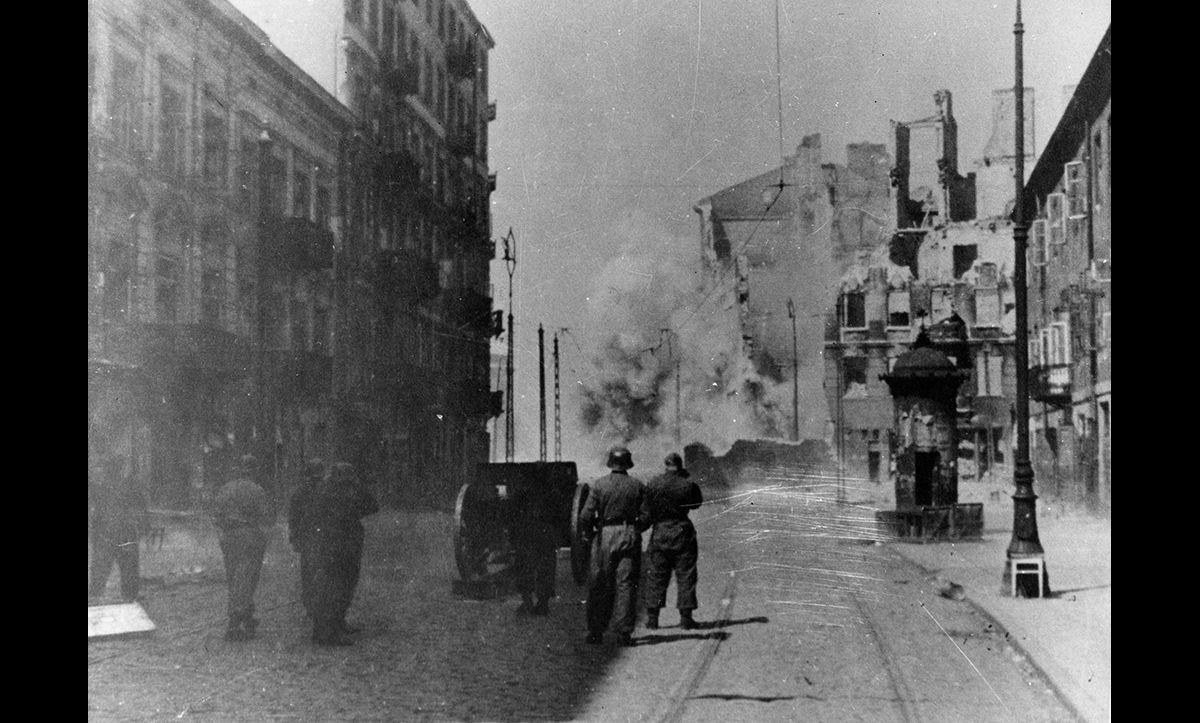 German troops sweeping through the Warsaw Ghetto in May 1943 following the Uprising. This photograph is also taken from the Stroop Report.