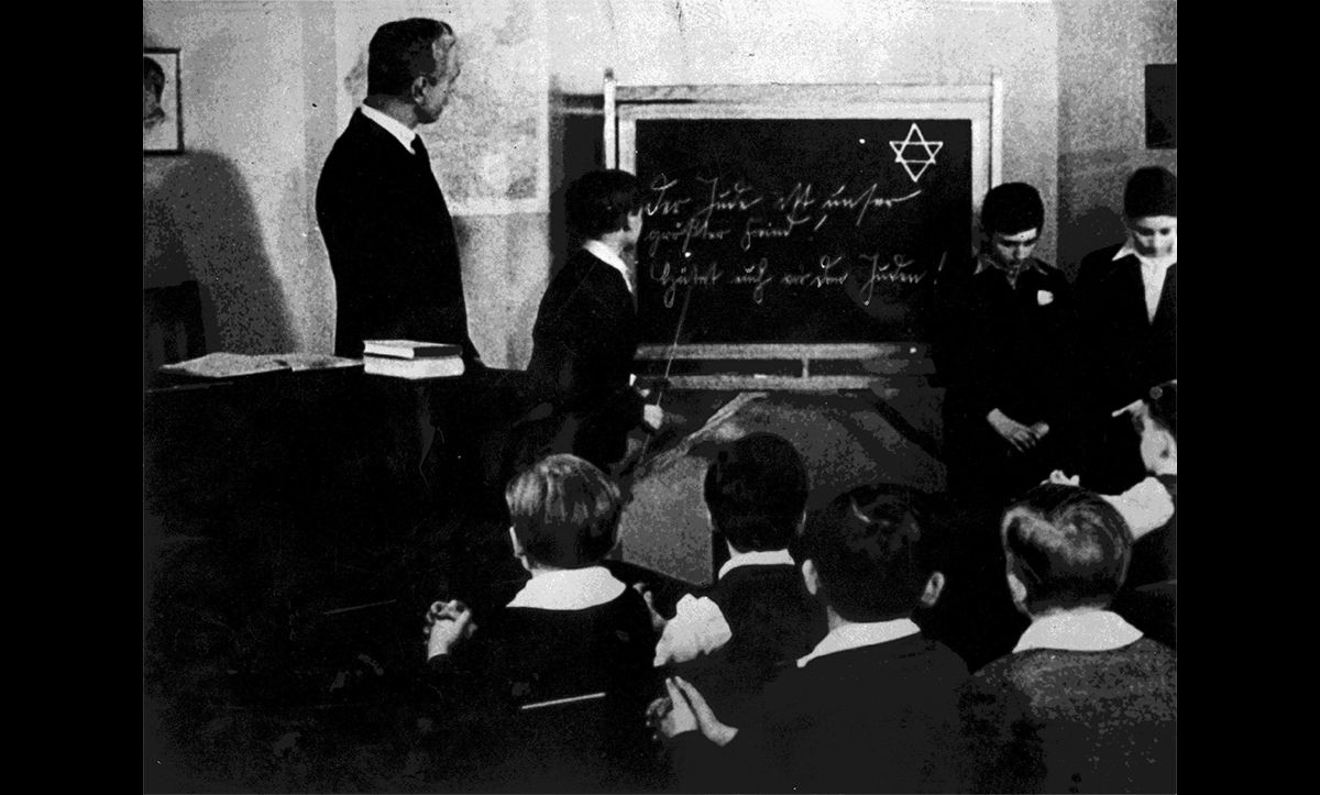 This photograph shows two young Jewish boys being used as examples in a German classroom in the 1930s. It demonstrates one way in which teachers in Germany collaborated with the Nazis – teaching their ideas about race.