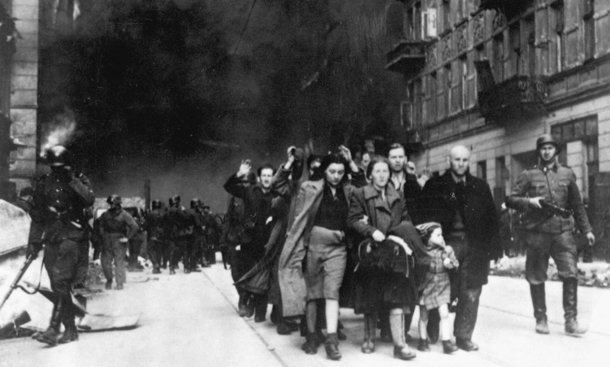 This photograph was taken as part of a report on the 1943 Warsaw Ghetto Uprising prepared for Heinrich Himmler by SS Commander Jürgen Stroop. It shows the inhabitants of the Warsaw Ghetto being forcibly removed and deported to extermination camps.