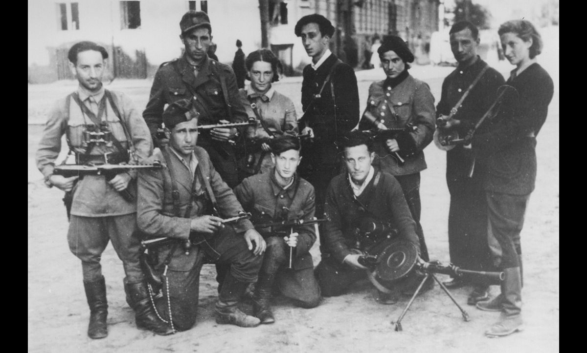A group of Jewish partisans, initially formed in the Vilna Ghetto, who went on to operate in the forests outside of Vilna between September 1943 and July 1944. They were led by Abba Kovner (centre back). This photograph also shows Rozka Korczak (third from left) and Vitka Kempner (far right).