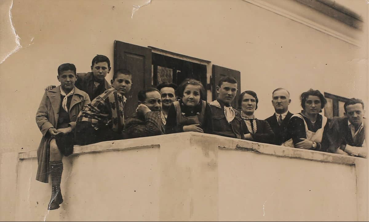 A picture of the Jaslowitz's with friends and family taken in Czernowitz 1933. Lotte is the second from the right, Sonja is in the middle, Harry is third from the left, and Adolf is fourth from the left.
