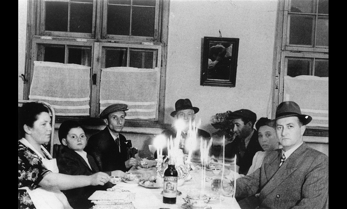 Religious traditions were quickly re-established at Landsberg. Here, the Gurfein family are pictured attending a Passover diner on 14 April 1949.