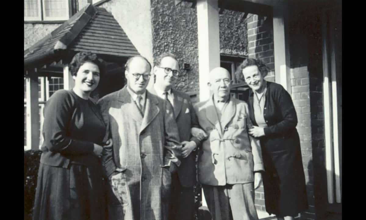 Ludwik Finkelstein (left) pictured next to his wife, Mirjam Finkelstein (nee Wiener) and father-in-law, Alfred Wiener (second from right) in the early 1960s.