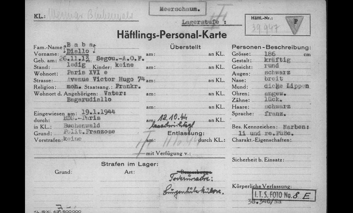The identification card for Baba Diallo, a Black member of the French resistance imprisoned in Buchenwald. On the top left hand corner of the card Diallo is described as 'Fr Neger'. On 11 October 1944, Diallo died in Buchenwald as a result of tuberculosis.
