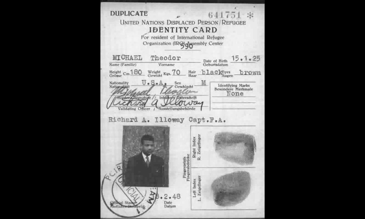 A postwar Displaced Persons (DP) identity card for Theodor Michael, a black German born in Berlin 1925. Prior to the war, Michael worked as an acrobat. He was later imprisoned by the Nazis and made to complete forced labour during the war.
