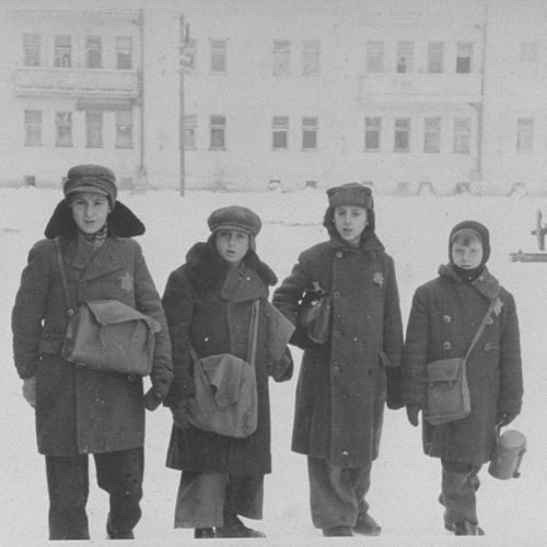 In Kovno (Kaunas) ghetto in Lithuania, the Jewish community established schools. This photograph shows four students of a religious school, photographed by Zvi Kadushin (George Kadish) 1941-1943,
