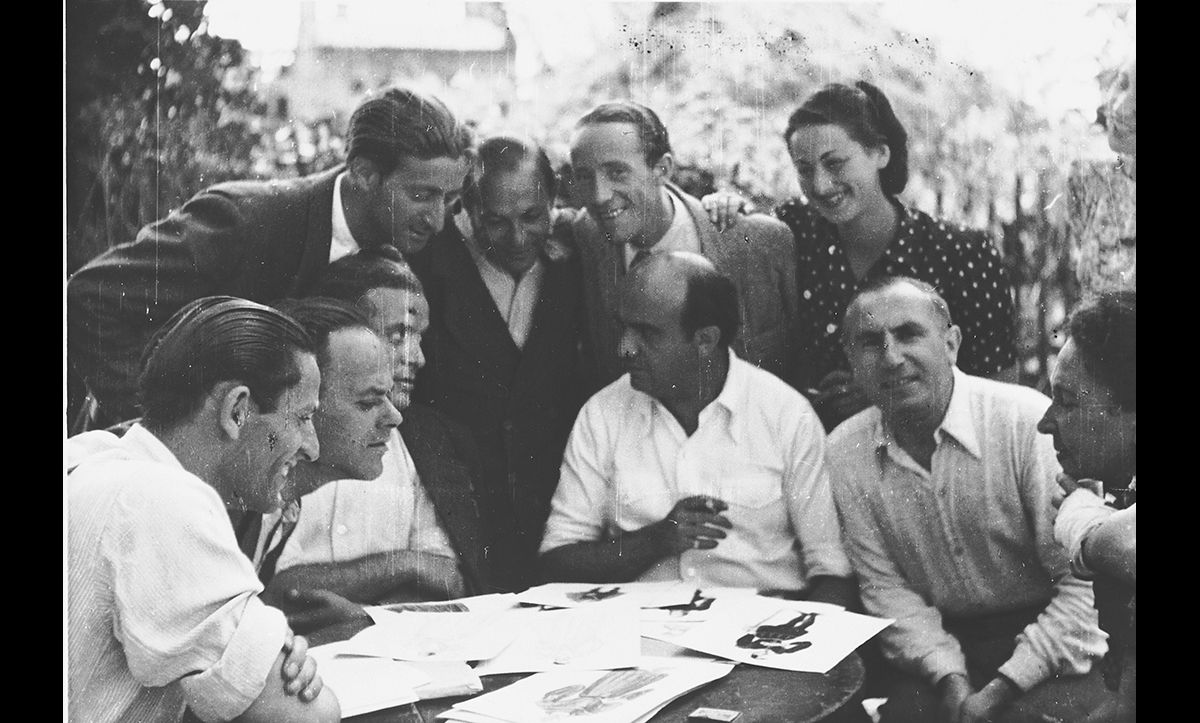 The Landsberg DP camp had a thriving cultural scheme of activities, including the Munich Jewish Theatre. Members of the theatrical group are pictured here examining costume designs.