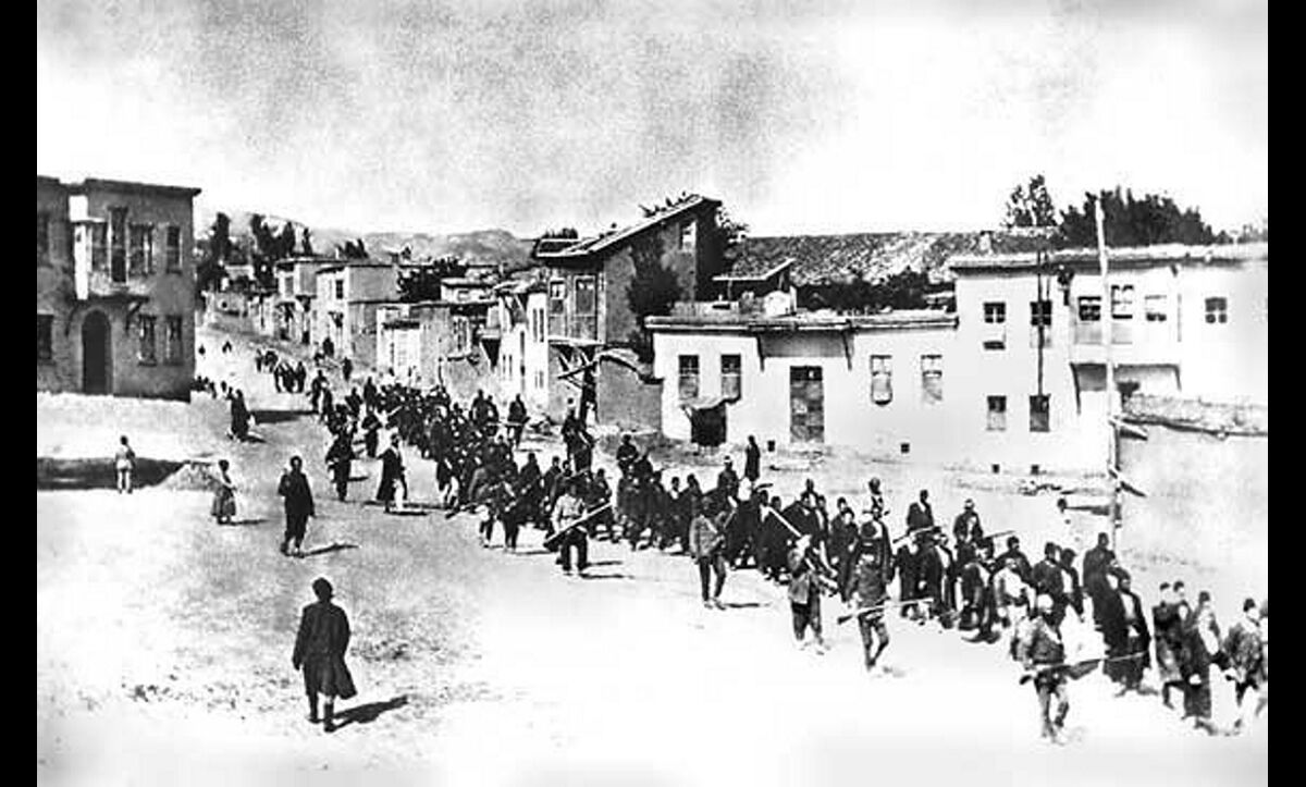 Soldiers from the Young Turk Ottoman Army escorting thousands of Armenians on lethal marches through the empire. C.1915.
