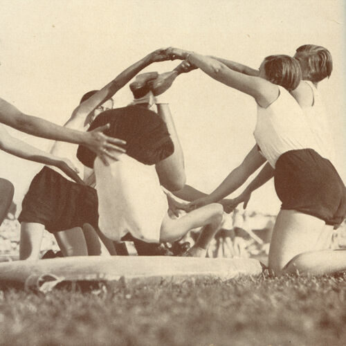 Photograph showing members of the Bund Deutscher Madel (The League of German Girls), a Nazi organisation for girls, performing acrobatics.