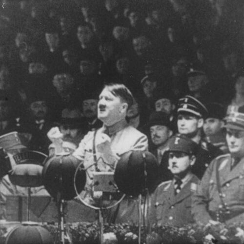 Adolf Hitler giving a speech at a Nazi party meeting.